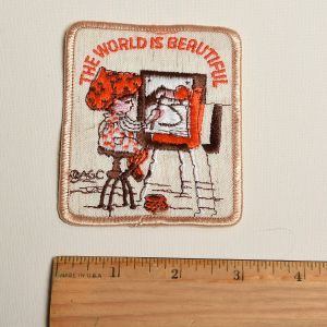 1970s Holly Hobbie The World Is Beautiful Embroidered Sew On Patch Artist Painting Art Applique - Fashionconstellate.com
