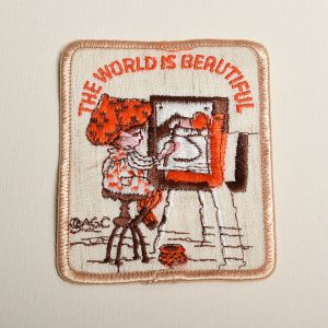 1970s Holly Hobbie The World Is Beautiful Embroidered Sew On Patch Artist Painting Art Applique