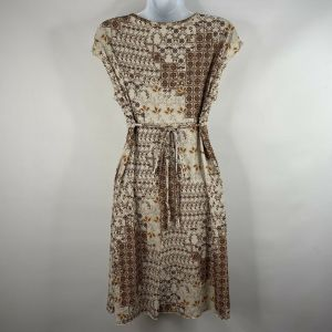 Vintage 70s Ivory Brown Floral Patchwork Polyester Empire Waist Mini Dress Size S - Fashionconstellate.com